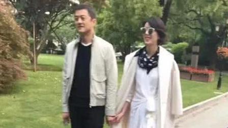 八卦:牵手新女友?李亚鹏与短发女子逛公园