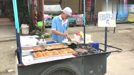 泰国街头的鲷鱼烧美食,旋转的烤炉很有趣