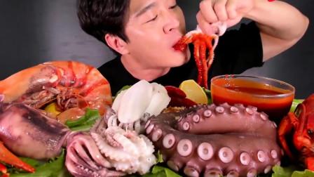 大胃王美食吃播,韩国小哥吃海鲜煮章鱼,蘸酱后的口感真是棒!