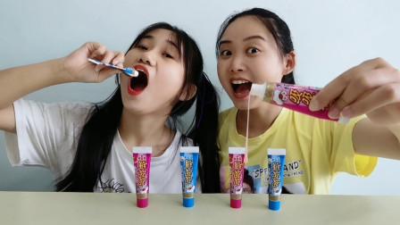 """俩吃货吃""""吸吸糖"""",形似牙膏挤着吃,果香奶味浓超甜蜜"""