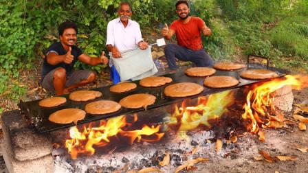 心善的印度爷爷做很多巧克力煎饼,给全村的孩子吃,感动全村人