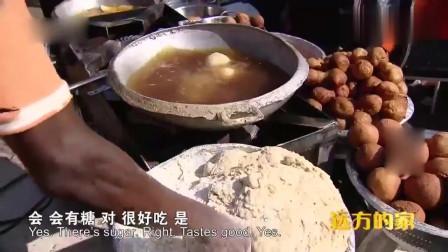 远方的家:尼日利亚首都街头的小吃店,看样子好吃,非洲女孩翻译中文很流利相关的图片