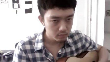 <走在雨中>,在午休的时候弹唱了一下,哈哈.