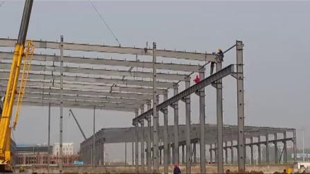 老友钢结构安装(安徽名筑钢塔1#厂房大梁吊装)
