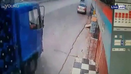 Car gets sandwiched and crushed by truck