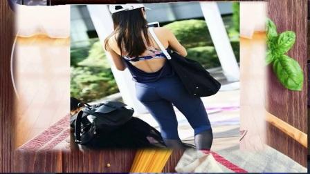 街拍,穿着露背上衣紧身瑜伽裤的少女,气质清