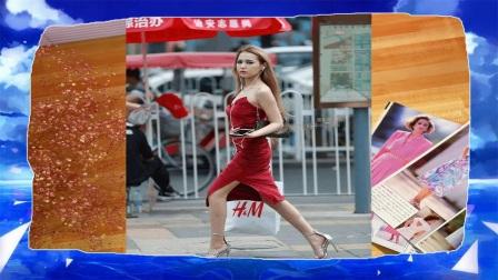 路人街拍一席红裙的冷艳高挑美女耀眼逛街