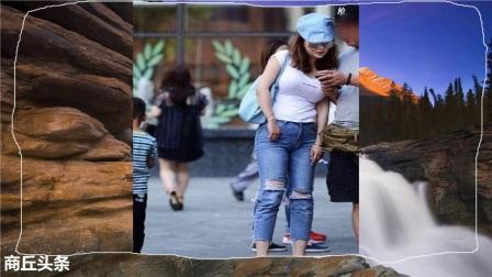 街拍美女穿破洞牛仔裤,优雅的姿态,充满自信