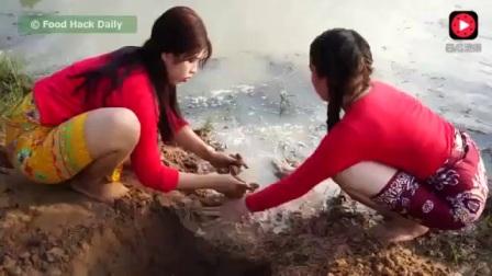 越南农村美女抓鱼
