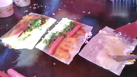 驻马店新春美食节上日入千元的美味有点怪,鸡蛋裹在煎饼外