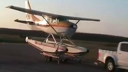 塞斯纳206水上飞机由丰田车曳拖起飞