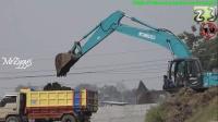 神钢挖掘机与小松推土机在泰国工作