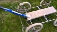 角磨机加上一台手推车, 就成了割草机, 想是想的出来! 天才啊