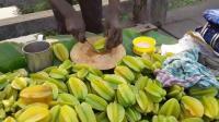 加尔各答食品街美味多汁的水果-杨桃的食法
