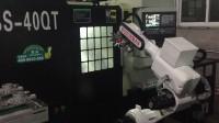 博尚关节机器人与数控车床组线上下料,加工汽车配件。