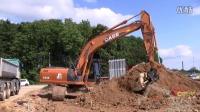 凯斯 CX210B挖掘机装载沃尔沃 Volvo 8x4自卸车