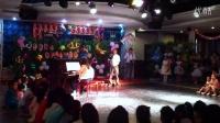 《六一儿童节音乐会》,石油大院文体中心演出,四手联弹(老师、一四班孙冠宇)