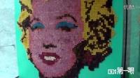 <上海>艺术家在沪秀绝技用6千片面包拼出梦露画像