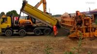 道路施工:移动式沙土摊铺机