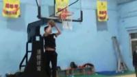 Shi shoot at the basket.