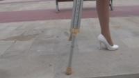 One-legged amputee lady crutching 03.mp4